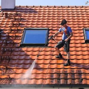 Contractor cleaning roof